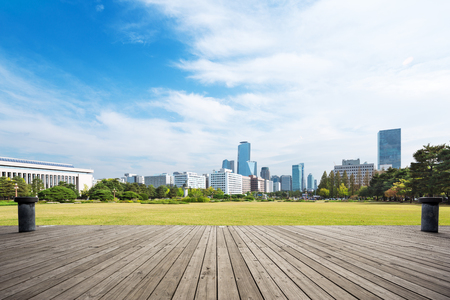 cityscape and skyline of seoul from empty wood floor