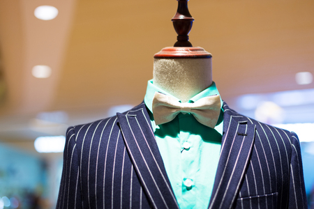 tailored: mens business suit in modern shopping mall