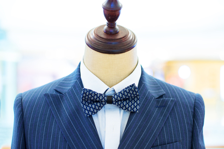 tailored: new style suit on mannequin in modern shopping mall