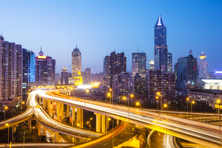 night scene of busy elevated road in midtown of modern city Stock Photo