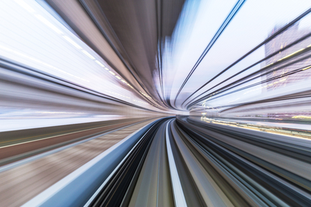 futuristic city: rail track and cityscape of tokyo on view from speed train Stock Photo