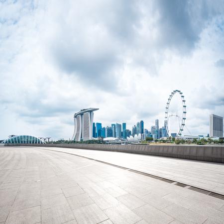 landmark buildings near marina bay in singapore from empty brick floor Editorial