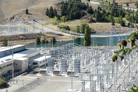 power transmission station near river in summer day in new zealand