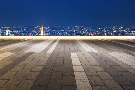 modern buildings near tokyo tower at night from empty floor
