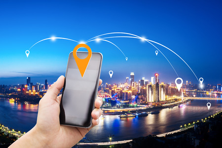 mobile phone with cityscape of chongqing at night Stock Photo