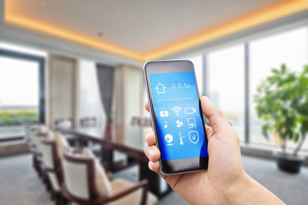 smart phone with apps in luxury meeting room