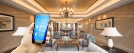 smart phone with apps in luxury living room Zdjęcie Seryjne