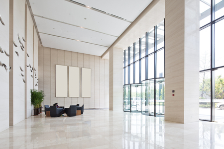 interior of spacious and bright entry hall in modern office building 스톡 콘텐츠
