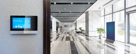 smart screen on wall with spacious hall in modern office building 報道画像