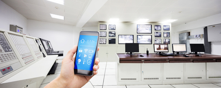 smart phone with smart home and control center in modern factory 報道画像