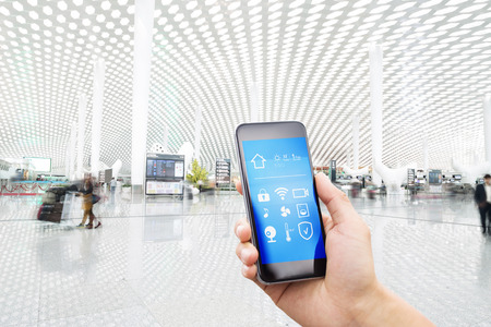 smart phone with smart home and modern airport hall