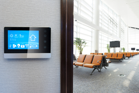 smart screen with smart home and modern airport hall Editorial