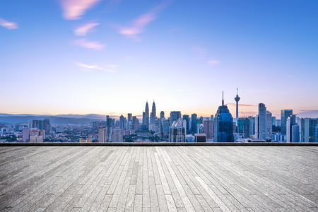 empty brick floor and cityscape of kuala lumpur at dawn