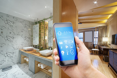 smart phone with smart home and modern bathroom Editorial