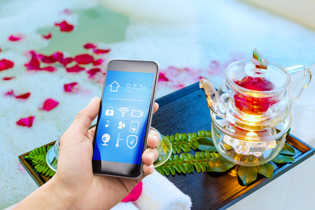 smart phone with smart home and modern bathroom in spring hotel Stock Photo