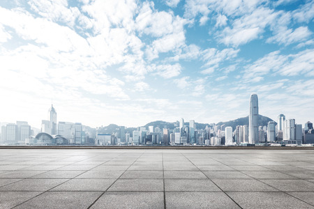 empty concrete floor and cityscape of hong kong in blue cloud sky Banque d'images