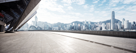 empty marble floor and cityscape of hong kong in blue cloud sky  写真素材