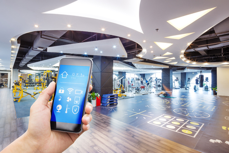 smart phone with smart home and modern gym Editorial