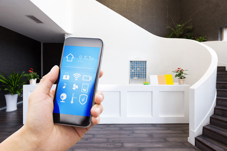 smart phone with smart home and staircase in modern gym Stock Photo