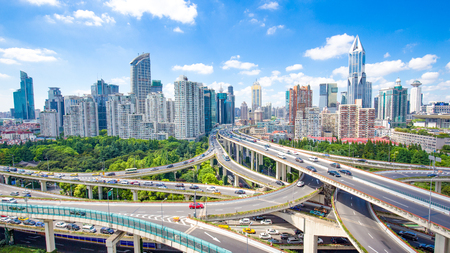 road junction and modern buildings in shanghai in blue cloud sky from high angle view 写真素材