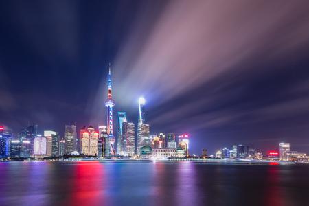 modern buildings near river in shanghai lujiazui CBD in cloud sky at night