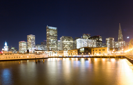 night scene of modern buildings by the river in san francisco Editorial