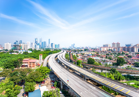 elevated road and modern buildings in kuala lumpur from high angle