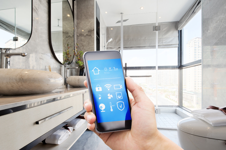 smart home system on mobile phone with background of modern washroom Editorial