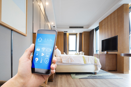 smart phone with smart home and modern Editorial