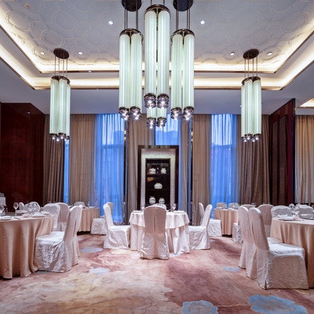 Wedding hall or other function facility set for fine dining Редакционное
