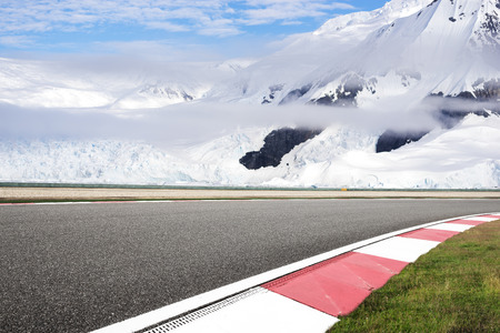 empty asphalt road with snow mountain Stock Photo - 102931257
