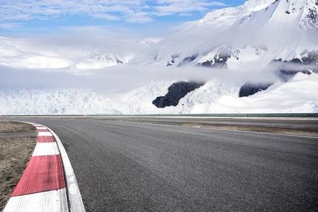 empty asphalt road with snow mountain Stock Photo - 102932031