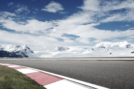 empty asphalt road with snow mountain Stock Photo - 102931727