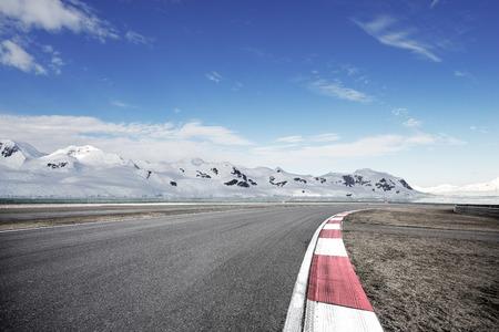 empty asphalt road with snow mountain Stock Photo - 102931613