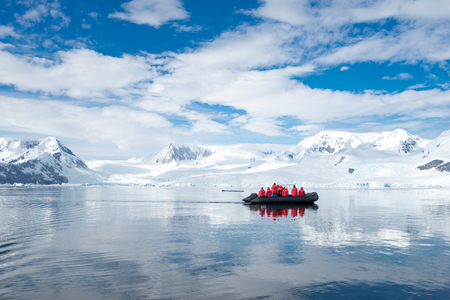 Inflatable boat full of tourists, watching for whales and seals, Antarctic Peninsula, Antarctica