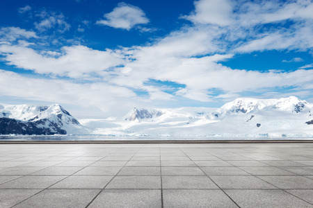 empty brick ground with snow mountain as background
