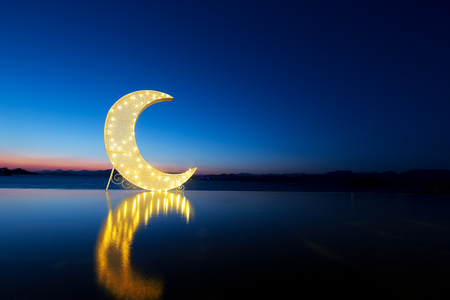 moon over water with flection Stock Photo