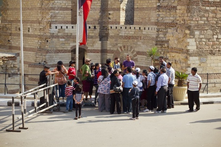 Group of tourists beside Roman fort Babylon in Cairo