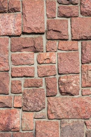 granit: Red granit blocks in concrete