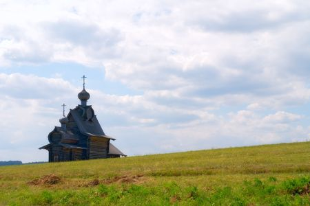 hillock: Old wooden church on a hillock Stock Photo