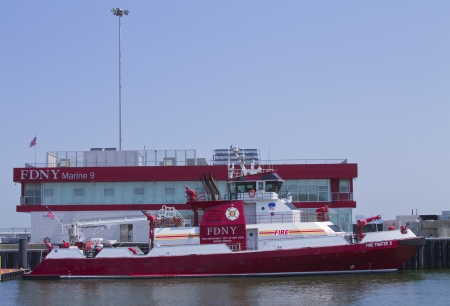 fire fighter:  FDNY fire fighter boat docked in New York harbor Editorial
