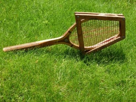 stringent: Vintage tennis racket  on grass court