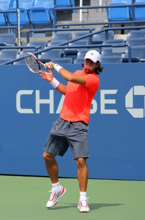 FLUSHING, NY - AUGUST 21: Professional tennis player Fernando Verdasco practices for US Open at Louis Armstrong Stadium at Billie Jean King National Tennis Center on August 21, 2012 in Flushing, NY. Stock Photo - 15509157
