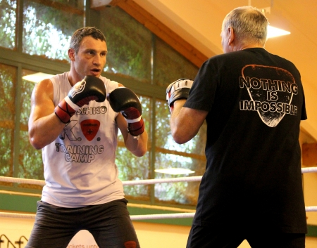 Going, Austria - August, 30: Current  World heavyweight champion boxer Vitali Klitschko  getting ready for championship fight August 30, 2012 at  training camp in Stangwirl resort, Tirol, Austria Editorial