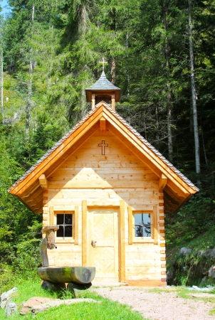 Small wooden church in Austrian Alps  photo