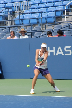 flushing: FLUSHING, NY - AUGUST 23: Professional tennis player and four time Grand Slam champion Maria Sharapova practices for US Open at Louis Armstrong Stadium at Billie Jean King National Tennis Center on August 23, 2012 in Flushing, NY.