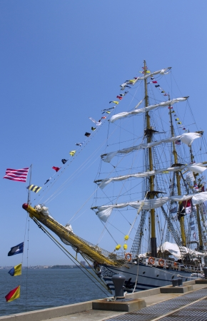Tall ship decorated with maritime signal flags in New York harbor photo