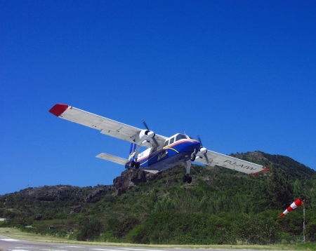 collectivity: Small plane taking off from St  Barths airport