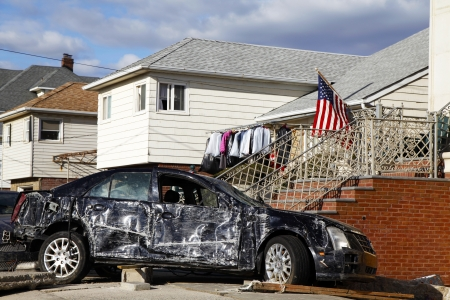 the aftermath: FAR ROCKAWAY, NY - NOVEMBER 4: Destroyed car in the aftermath of Hurricane Sandy on November 4, 2012 in Far Rockaway, NY