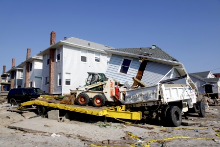 the aftermath: FAR ROCKAWAY, NY - NOVEMBER 11: Destroyed beach house and truck in the aftermath of Hurricane Sandy on November 11, 2012 in Far Rockaway, NY Editorial